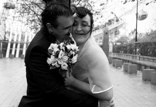 Black and white picture of a bride and groom hugging by Fiona Kelly Photography