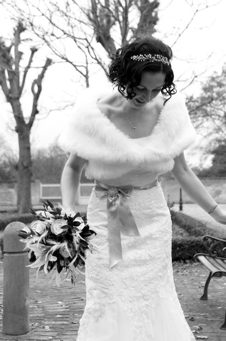 Black and white picture of a bride looking down by Fiona Kelly Photography
