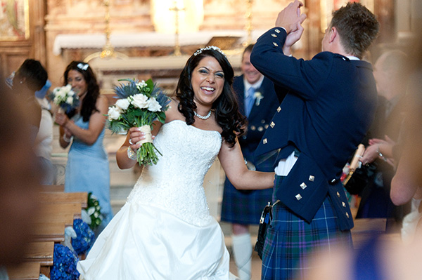 Picture of a bride laughing with her groom by Fiona Kelly Wedding Photography