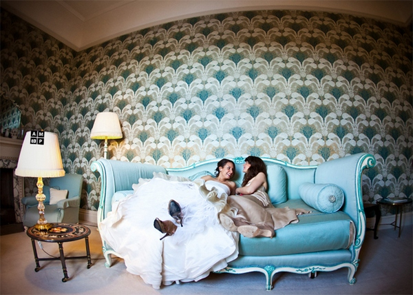 Picture of a bride laying on a sofa by Anneli Marinovich Photography