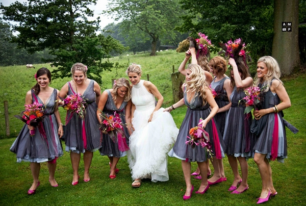 Picture of a bride and her bridesmaids walking across a field by Anneli Marinovich Photography