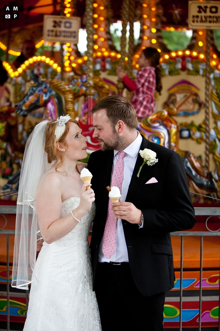 Picture of a bride and groom eating ice cream at a fairground by Anneli Marinovich Photography