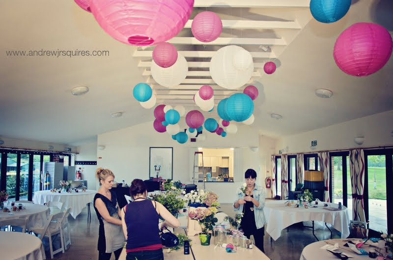 Setting up a wedding reception room by Andrew J R Squires Photography