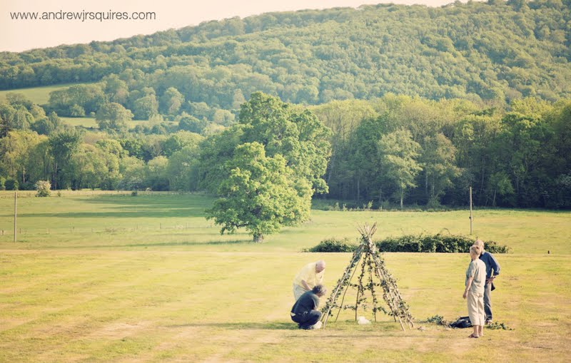 Field being prepared for a wedding reception by Andrew J R Squires Photography