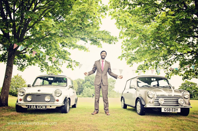 Groom standing by Mini wedding cars by Andrew J R Squires Photography