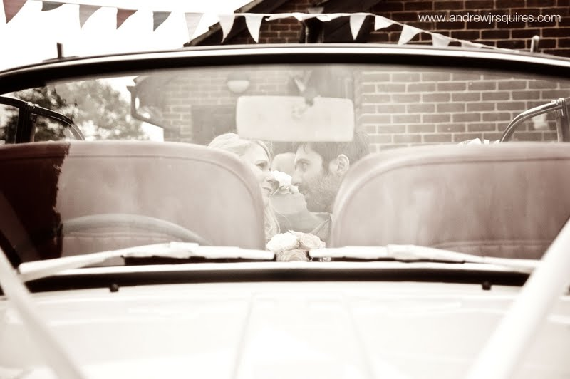 Bride and groom in the back of a car by Andrew J R Squires Photography