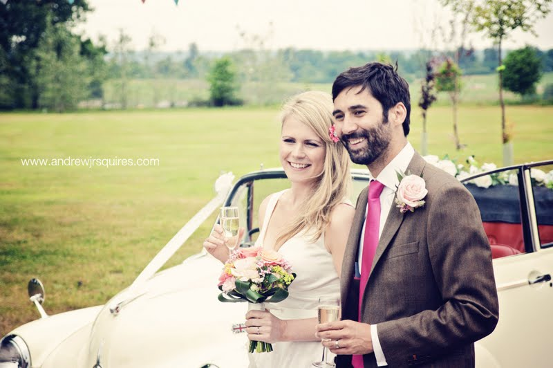 Happy bride and groom by Andrew J R Squires Photography