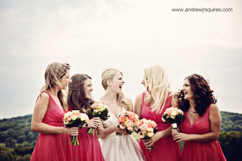 A bride laughing with her bridesmaids by Andrew J R Squires Photography