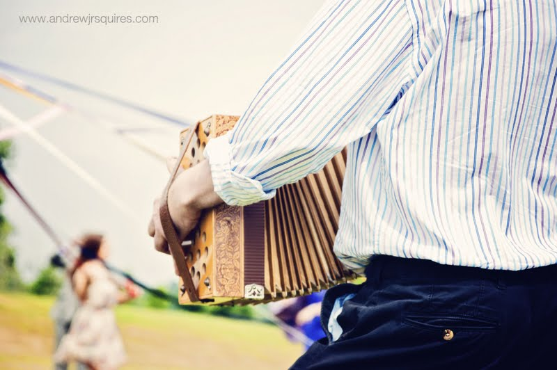 Accordion player at a wedding by Andrew J R Squires Photography