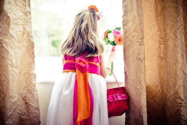 Flower girl looking out of a window - Martins Kikulis Photography