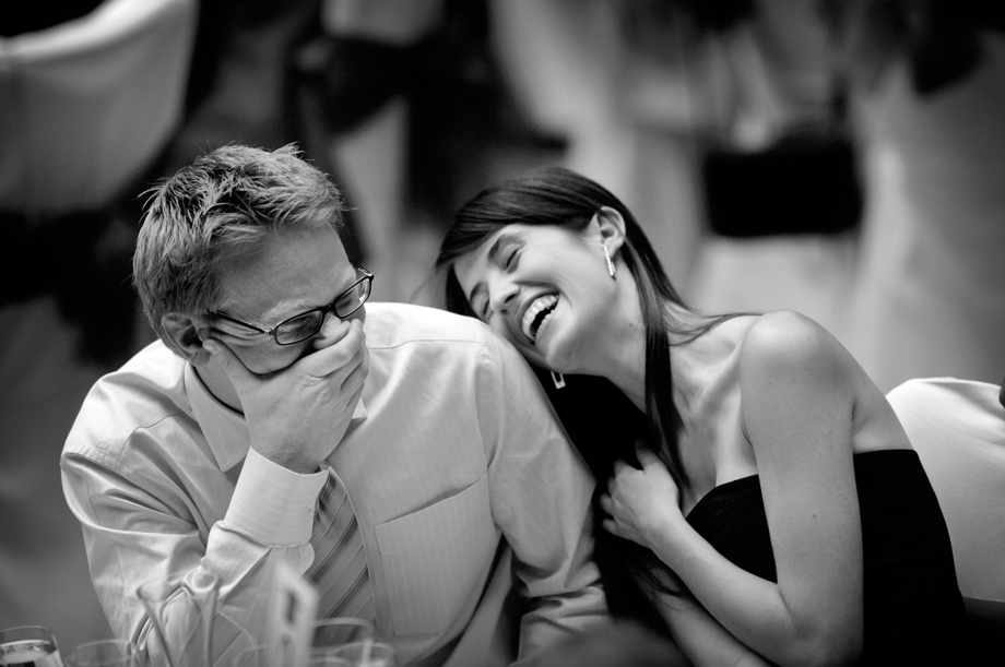 Wedding guests laughing by Martin Beddall Photography