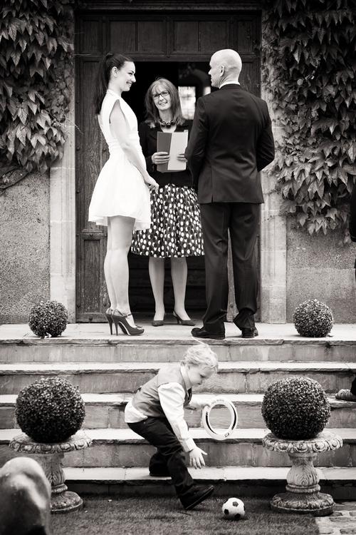 Bride and groom with registrar - Sam Gibson Wedding Photography