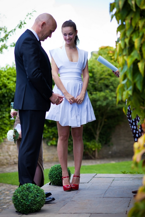 Bride and groom saying vows - Sam Gibson Wedding Photography