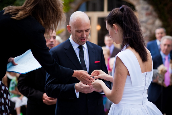Bride and groom exchanging rings - Sam Gibson Wedding Photography