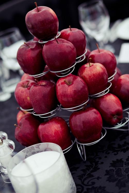 Red apple wedding table display - Sam Gibson Wedding Photography