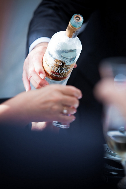 Pouring Russian vodka - Sam Gibson Wedding Photography