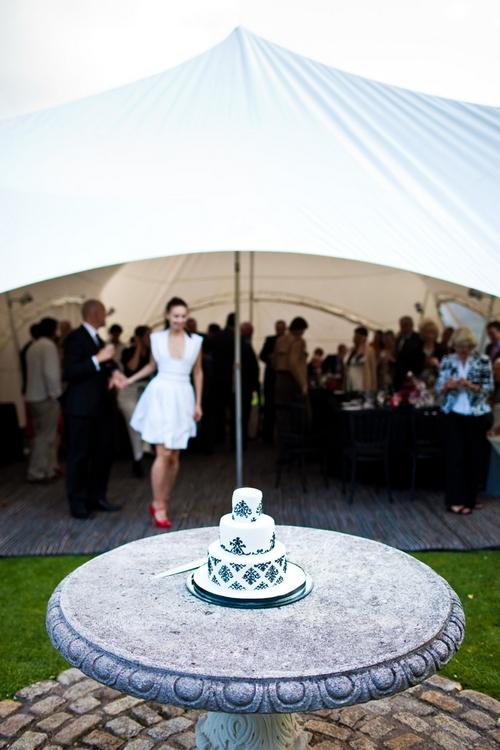 Bride and groom preparing to cut the wedding cake - Sam Gibson Wedding Photography