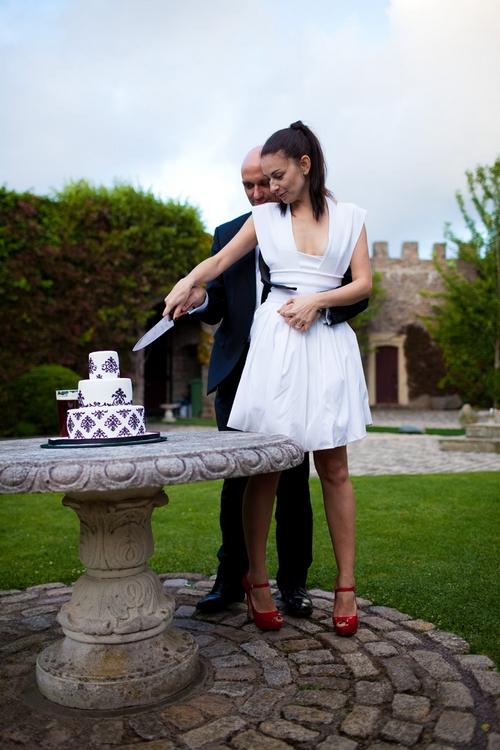 Bride and groom cutting wedding cake - Sam Gibson Wedding Photography