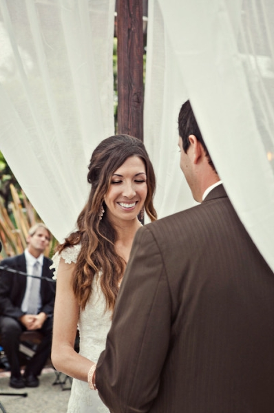 Bride smiling during wedding ceremony - Picture by Captured by Aimee