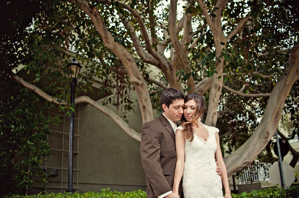 Bride and groom standing in front of a tree - Picture by Captured by Aimee