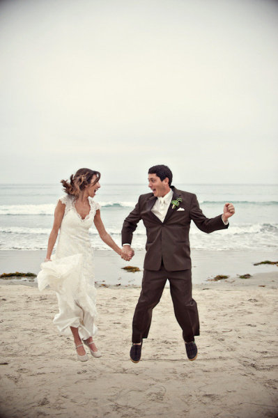 Bride and groom jumping on beach - Picture by Captured by Aimee