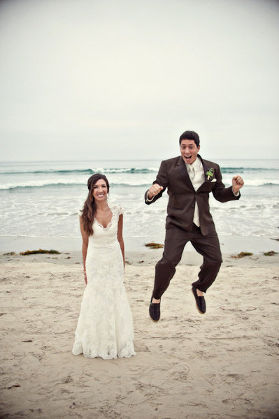 Groom jumping on beach - Picture by Captured by Aimee