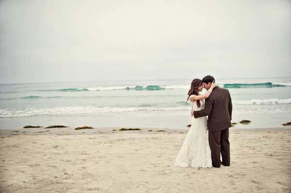 Bride and groom on beach - Picture by Captured by Aimee