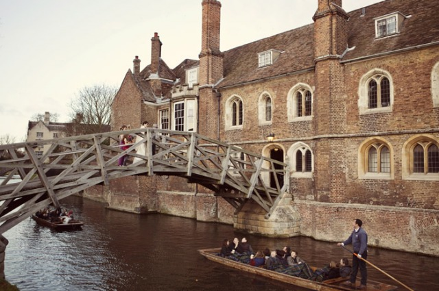 Bride walking over bridge at Queen's College Chapel - Picture by Laura McCluskey Photography