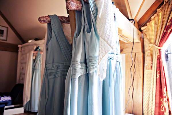 Light blue bridesmaid dresses hanging up - Picture by Andrew J R Squires Photography