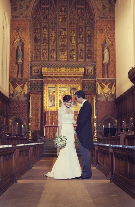 Bride and groom in Queen's College Chapel - Picture by Laura McCluskey Photography