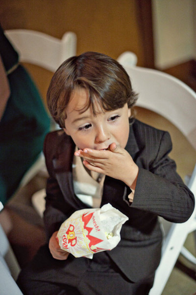 Small boy eating popcorn - Picture by Captured by Aimee