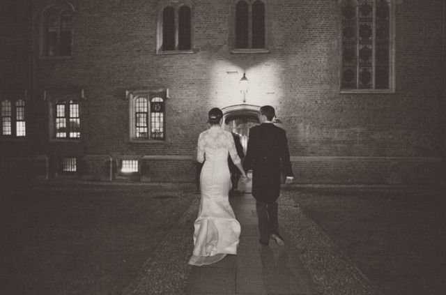 Bride and groom walking into Magdalene College