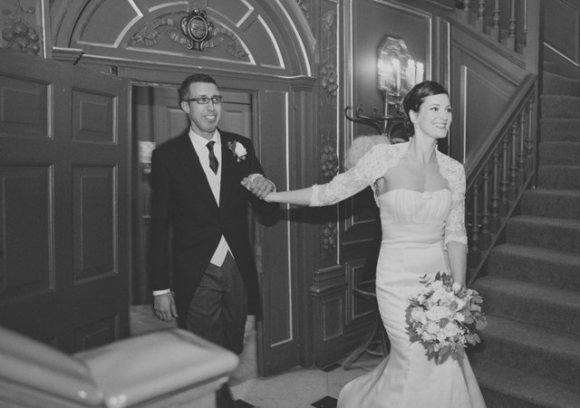 Bride and groom holding hands - Picture by Laura McCluskey Photography