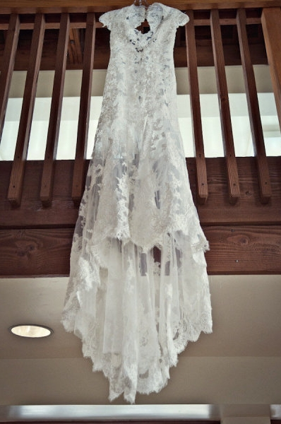 Wedding dress hanging from rail - Picture by Captured by Aimee