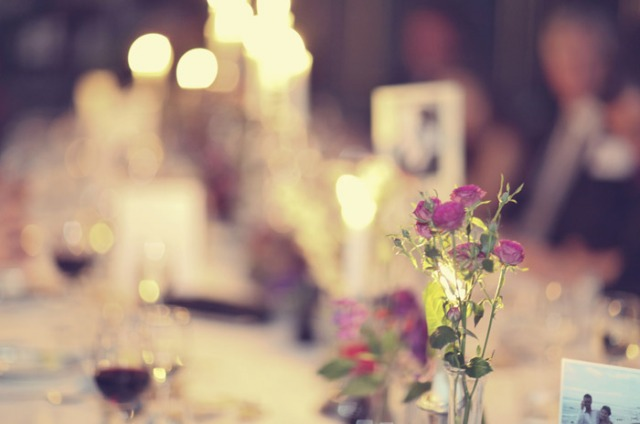 Flowers on a wedding table - Picture by Laura McCluskey Photography