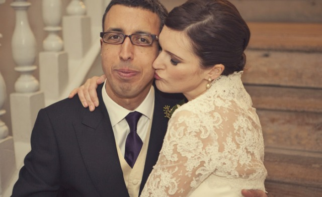 Bride kissing groom on cheek - Picture by Laura McCluskey Photography