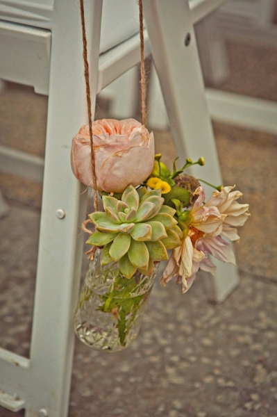 Flowers in vase hanging from chair - Picture by Captured by Aimee