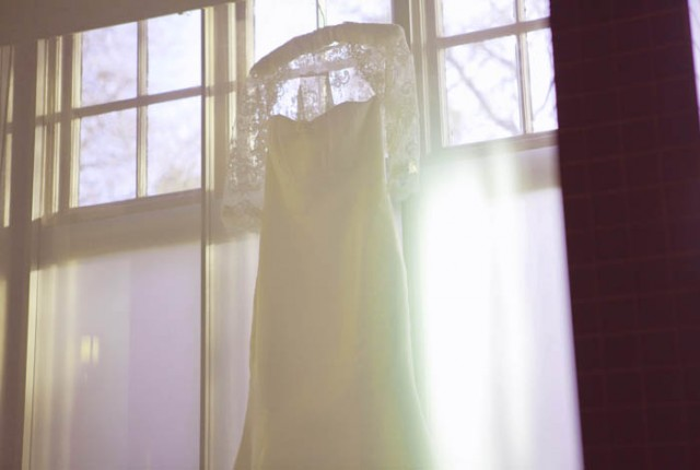 Hanging Vera Wang wedding dress - Picture by Laura McCluskey Photography