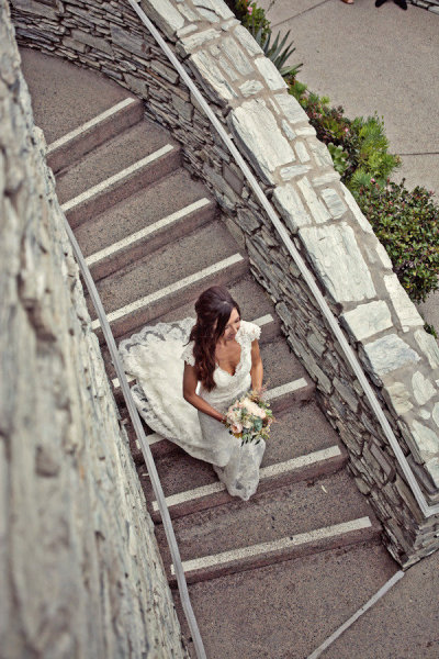 Bride walking down stairs - Picture by Captured by Aimee