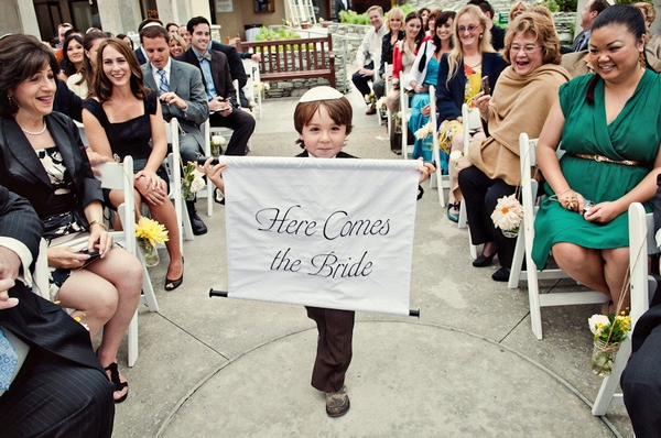 Boy holding Here Comes the Bride sign - Picture by Captured by Aimee