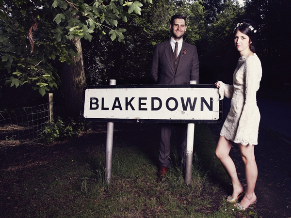 Bride and groom standing by Blakedown sign - Picture by Ian Shoots Weddings