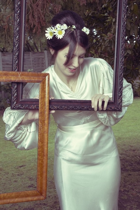Bride posing with picture frames - Picture by Ian Shoots Weddings