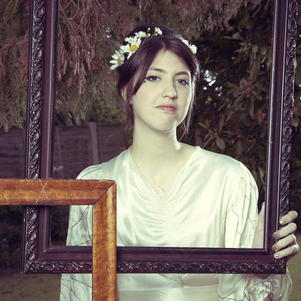 Bride holding picture frame - Picture by Ian Shoots Weddings