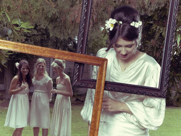 Bride and bridesmaids posing with picture frames - Picture by Ian Shoots Weddings