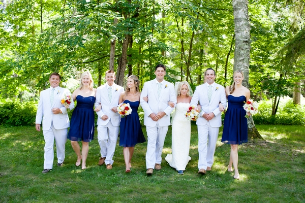 Bridal party walking arm in arm - Picture by Laura Ivanova Photography
