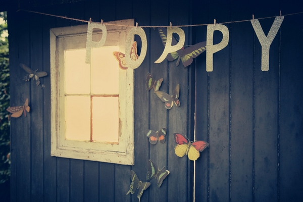 Poppy letters hanging in front of shed - Picture by Ian Shoots Weddings