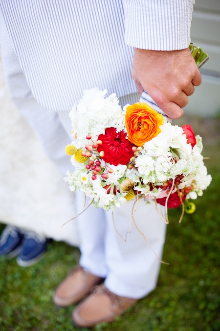 Groom holding bouquet - Picture by Laura Ivanova Photography