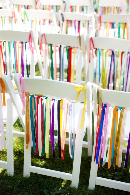 Coloured ribbon hanging on chairs - Picture by Laura Ivanova Photography
