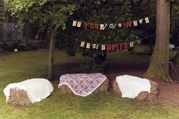 Bails of hay as seating at 1950s wedding reception - Picture by Ian Shoots Weddings