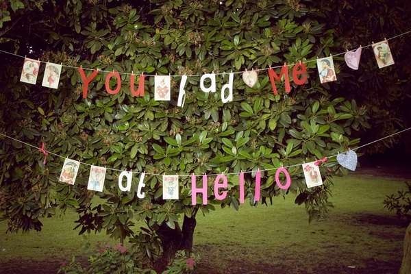 Hanging letters spelling 'You Had Me At Hello' - Picture by Ian Shoots Weddings